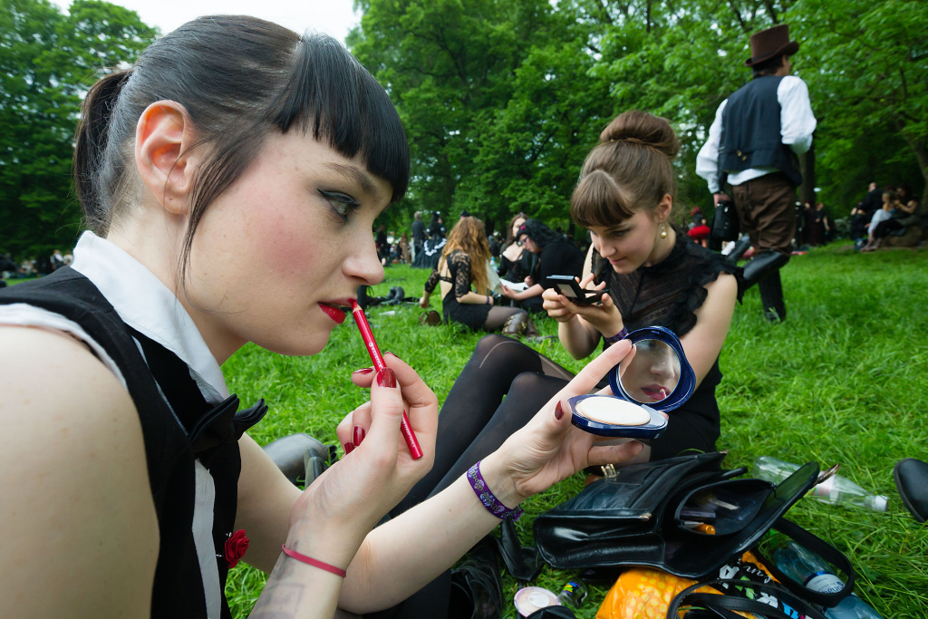 Two girls in black clothing refresh their make-up. A new poll looks at Americans'