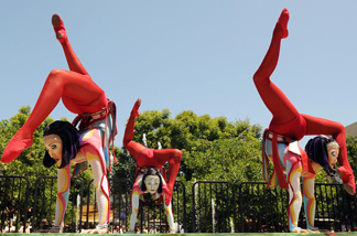 Artists perform at the Grove in Los Angeles on August 2, 2009 to celebrate the 25th anniversary of the Cirque du Soleil.
