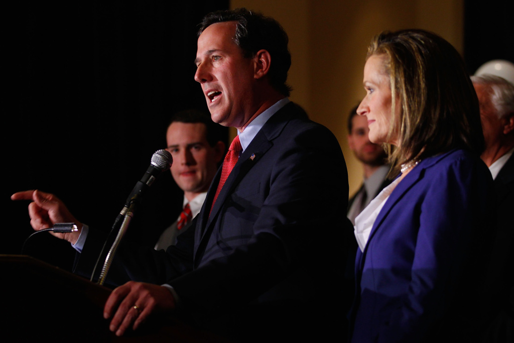 Republican presidential candidate, former U.S. Sen. Rick Santorum speaks to supporters as his son, John (L) and wife, Karen (R), look on February 7, 2012 at the St. Charles Convention Center in St. Charles, Missouri.