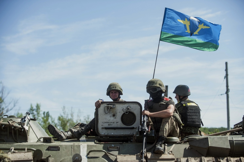 Ukrainian paratroopers sit on top an APC in Slovyansk, eastern Ukraine, Thursday, July 10, 2014. In the past two weeks, Ukrainian government troops have halved the amount of territory held by the rebels. Now they are vowing a blockade of Donetsk.