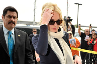 Lindsay Lohan arrives for a preliminary hearing to determine if she will stand trial for felony grand theft at the Airport Courthouse April 22, 2011 in Los Angeles, California.