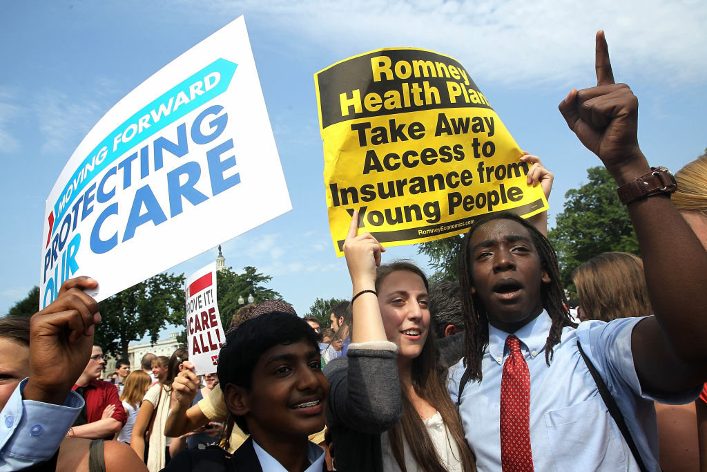 Supporters of the Affordable Care Act celebrate the Supreme Court ruling which upheld the whole healthcare law of the Obama Administration.