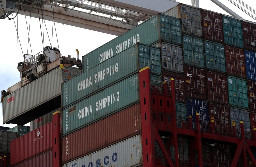 A shipping container is offloaded from the Hong Kong based CSCL East China Sea container ship at the Port of Oakland on June 20, 2018 in Oakland, California.