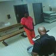In this undated frame from video provided by the Waller County Sheriff's Department, Sandra Bland stands before a desk at Waller County Jail in Hempstead, Texas.