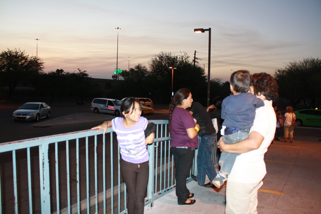 Women and children migrants wait outside of the Greyhound bus station in Tucson.