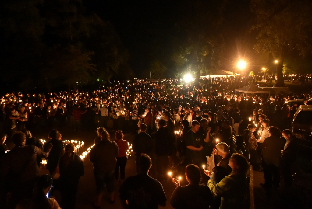 Hundreds of people gather for a vigil  in Roseburg, Oregon on October 1, 2015, for ten people killed and seven others wounded in a shooting at a community college in the western US state of Oregon. The 26-year-old gunman, identified by US media as Chris Harper Mercer, was killed following a shootout with police. A visibly angry President Barack Obama made an impassioned plea for gun control in the wake of the shooting, blasting Congress for its failure to act in the face of