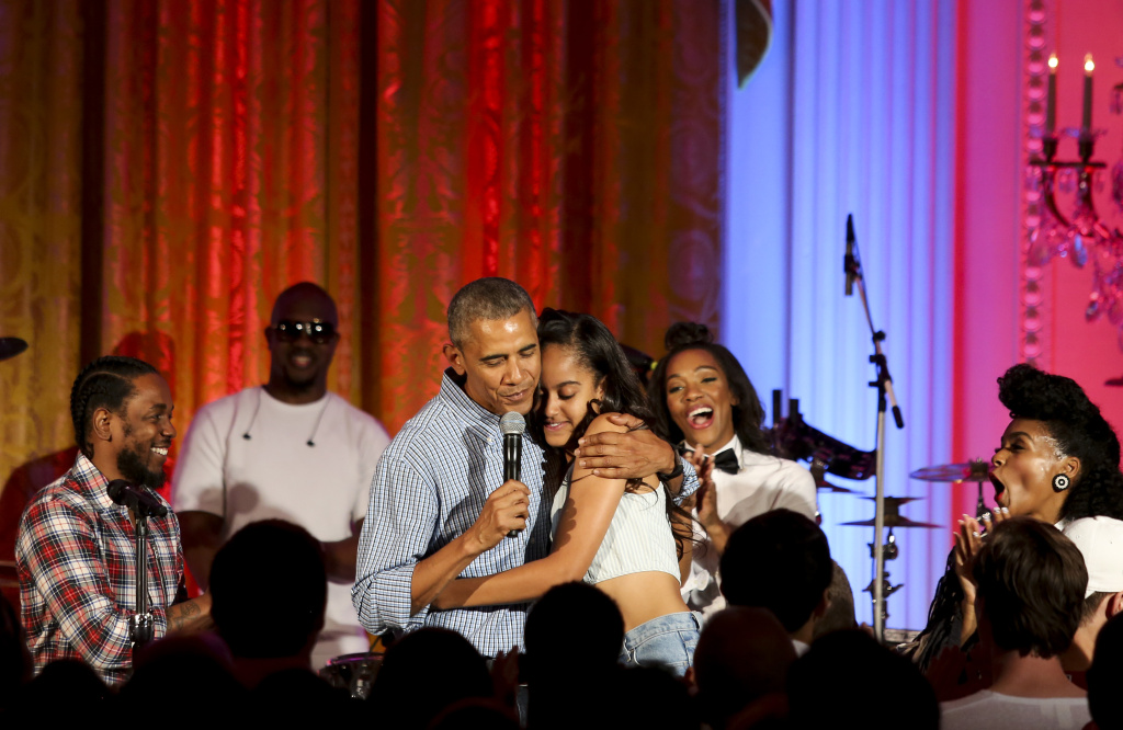 President Barack Obama hugs his daughter Malia Obama at the Fourth of July White House party on July 4, 2016 in Washington, DC. Maila Obama celebrated her 18th birthday during the party, which featured guests including singers Janelle Monae and Kendrick Lamar.