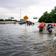 In this handout provided by the Army National Guard, Texas National Guardsmen rescue a resident by boat during flooding caused by Hurricane HarveyAugust 27, 2017 in Houston, Texas