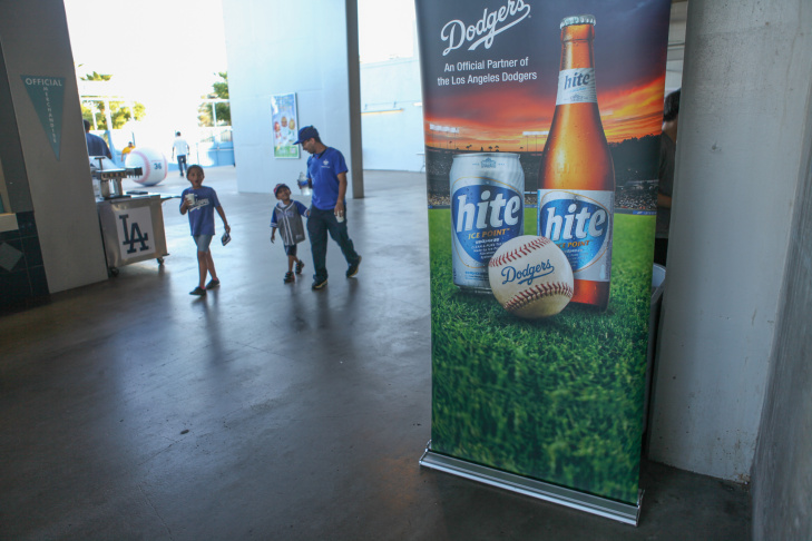 Dodgers fans sample a soju cocktail at a game on June 28.