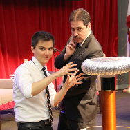 KPCC's science reporter Sanden Totten and Nikola Tesla, aka David Malki, pose next to a Tesla coil built by KPCC engineer Lance Harper for at KPCC's Crawford Family Forum celebration of Nikola Tesla's 158th birthday July 20, 2014.