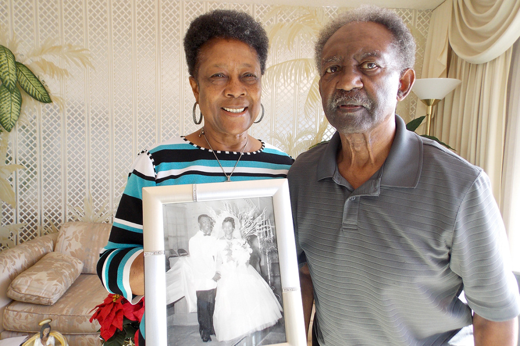 Dorothy and Levi Reeves stand in their Oakland home, holding their wedding photo from 57 years ago. Dorothy Reeves agreed to donate both of their brains after death to UC Davis for research.