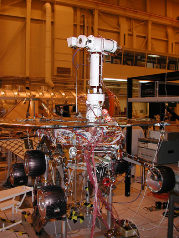 An artist's concept portrays a NASA Mars Exploration Rover on the surface of Mars. Two rovers have been built for 2003 launches and January 2004 arrival at two sites on Mars. Each rover has the mobility and toolkit to function as a robotic geologist.