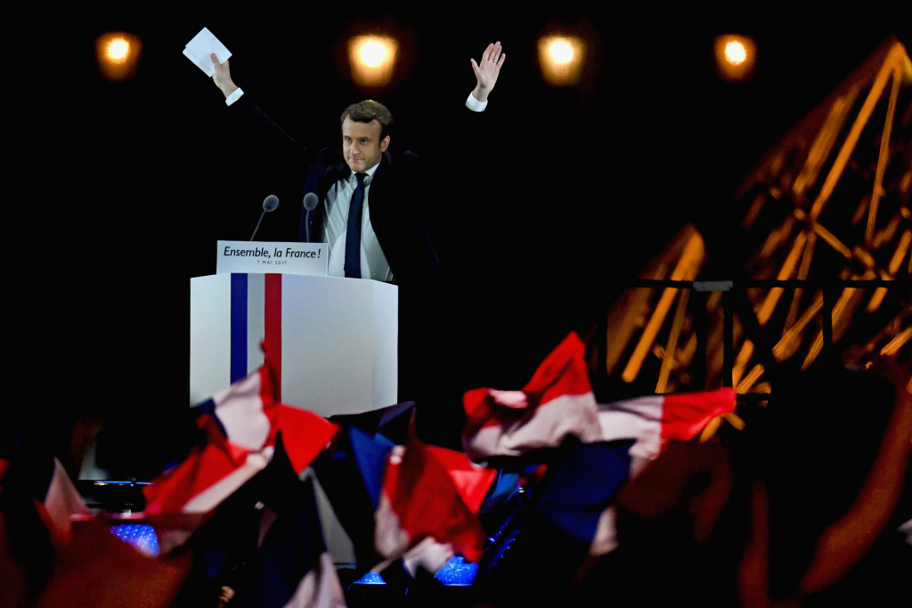 Leader of 'En Marche !' Emmanuel Macron acknowledges supporters after winning the French Presidential Election, at The Louvre on May 7, 2017 in Paris, France.