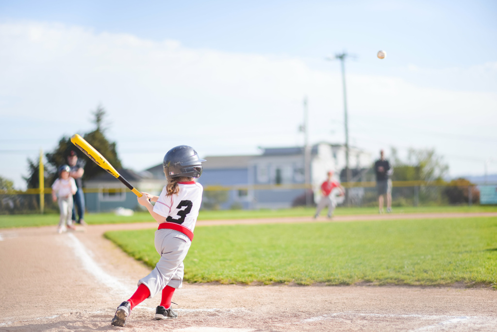 Coach Sean Eley assembled the Rockford Peaches with his daughter and her friends. They are the first ever West Seattle Little League team in the coach-pitch division composed entirely of girls.