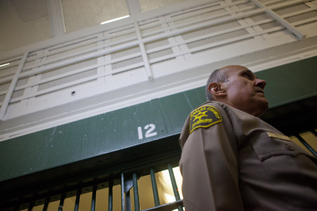 File: L.A. County Sheriff Lee Baca conducts an inspection of Men's Central Jail in Downtown Los Angeles in this photo from December 2011.