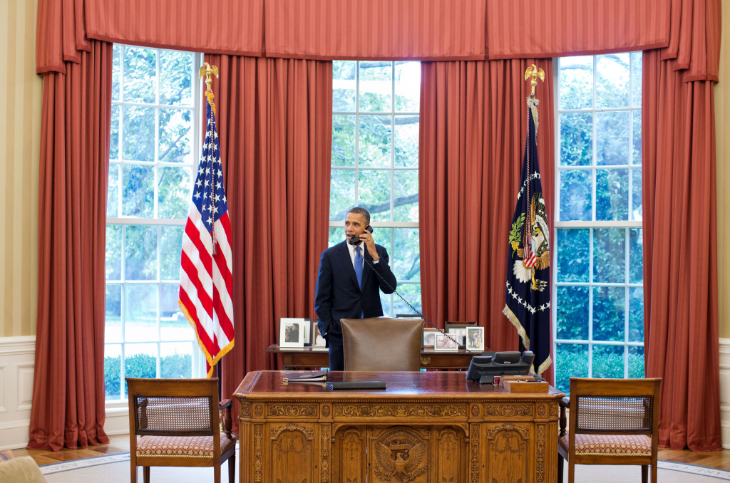 In this handout provided by the White House, U.S. President Barack Obama talks on the phone in the Oval Office.