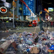 A sanitation worker cleans up Times Square after its New Year's Eve celebration.