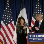 Republican presidential candidate Donald Trump shakes hands with former Alaska Gov. Sarah Palin.