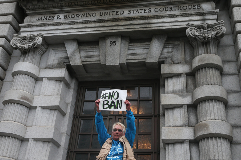 Opponents of U.S. President Donald Trump's executive order imposing a temporary immigration ban on seven Muslim-majority nations protest outside a federal appeals court February 7, 2016.