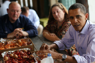 File photo: President Barack Obama and Adm. Thad Allen talk with community representatives at Grand Isle, Louisiana on June 4, 2010.  The President has visited the area three times since the BP oil spill in April.