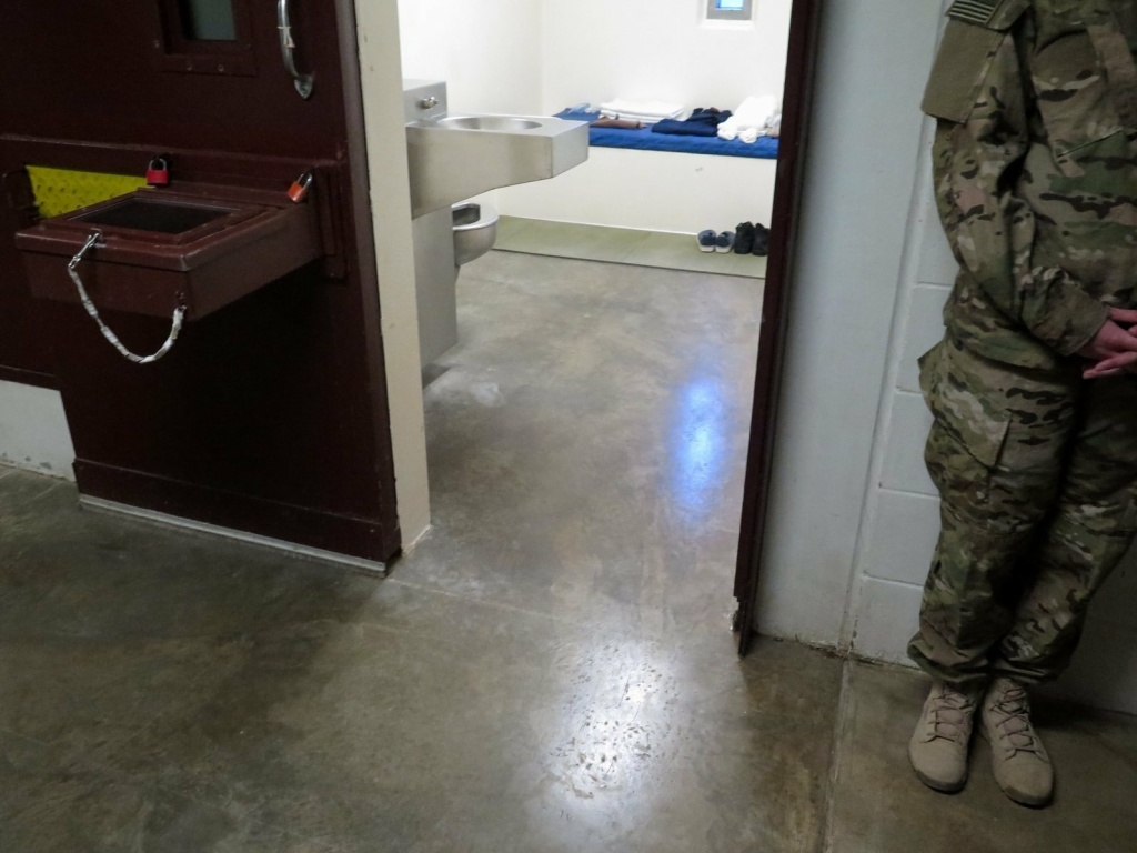 A U.S. military service member stands outside a prison cell at Camp 5. (Photo reviewed and cleared by U.S. military.)