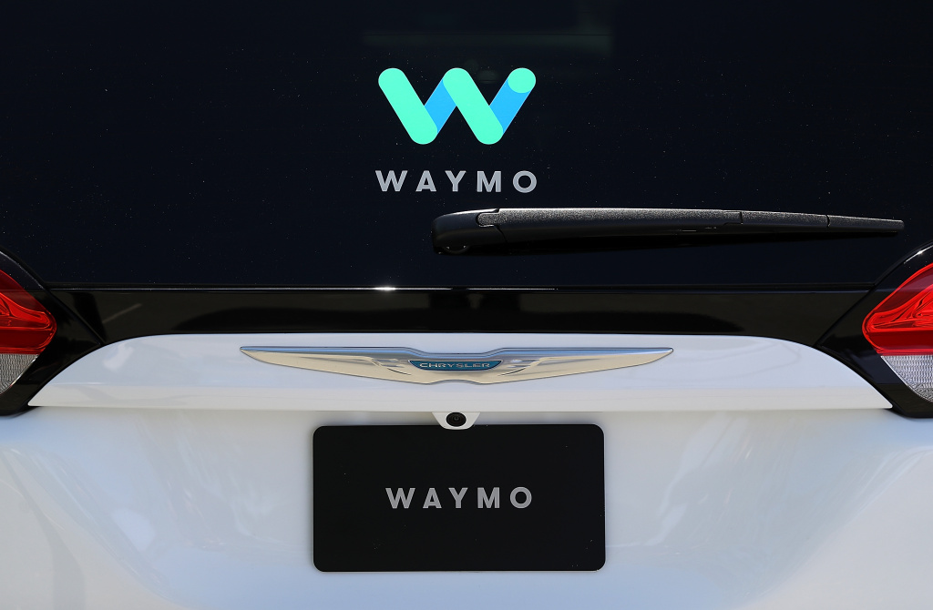 The Waymo logo is displayed on a self-driving vehicle at the Google I/O 2018 Conference at Shoreline Amphitheater on May 8, 2018 in Mountain View, California.