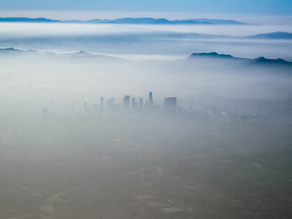 A view of Los Angeles from an airplane on approach to LAX, August 2007. Californians can find out how environmentally challenged are the neighborhoods they live in by using a new tool from released this week by the California Environmental Protection Agency.