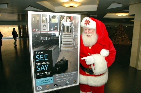 Santa promotes Metro safety at the free rides announcement on Thursday.