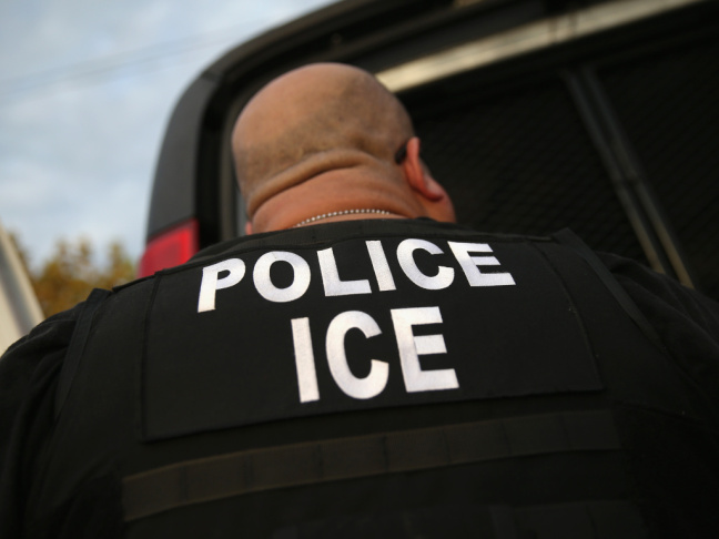 A U.S. Immigration and Customs Enforcement agent detains an immigrant in October 2015. Though the Department of Homeland Security says it is looking for recent arrivals, criminals and people with deportation orders, that hasn't reassured immigrants like G