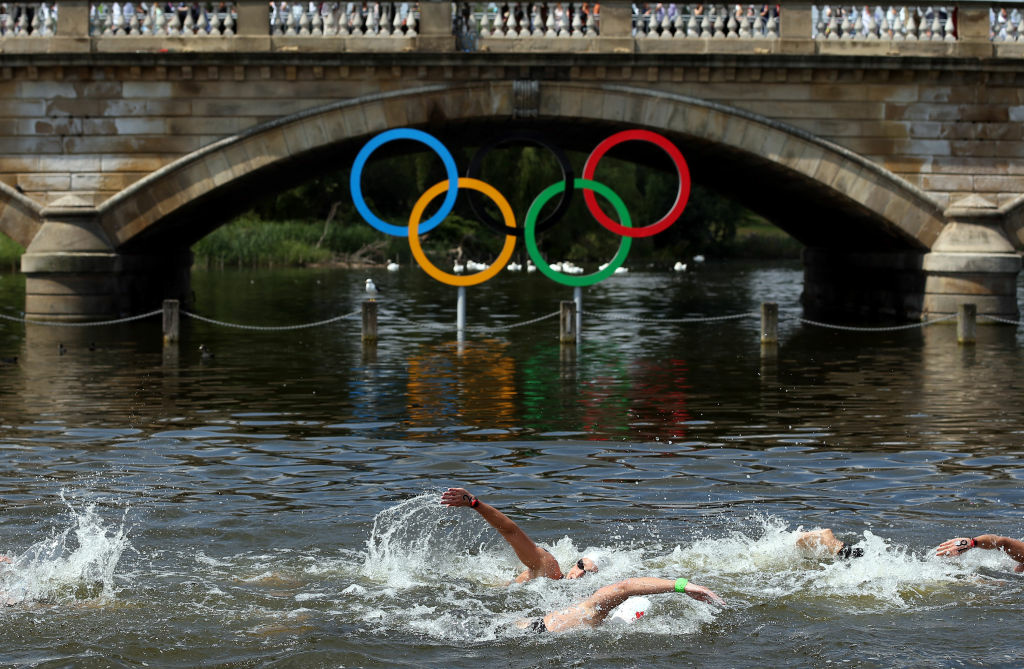 LONDON, ENGLAND - AUGUST 09:  Swimmers compete during the Women's Marathon 10km Swimming at Hyde Park on August 9, 2012 in London, England.  (Photo by Clive Rose/Getty Images)