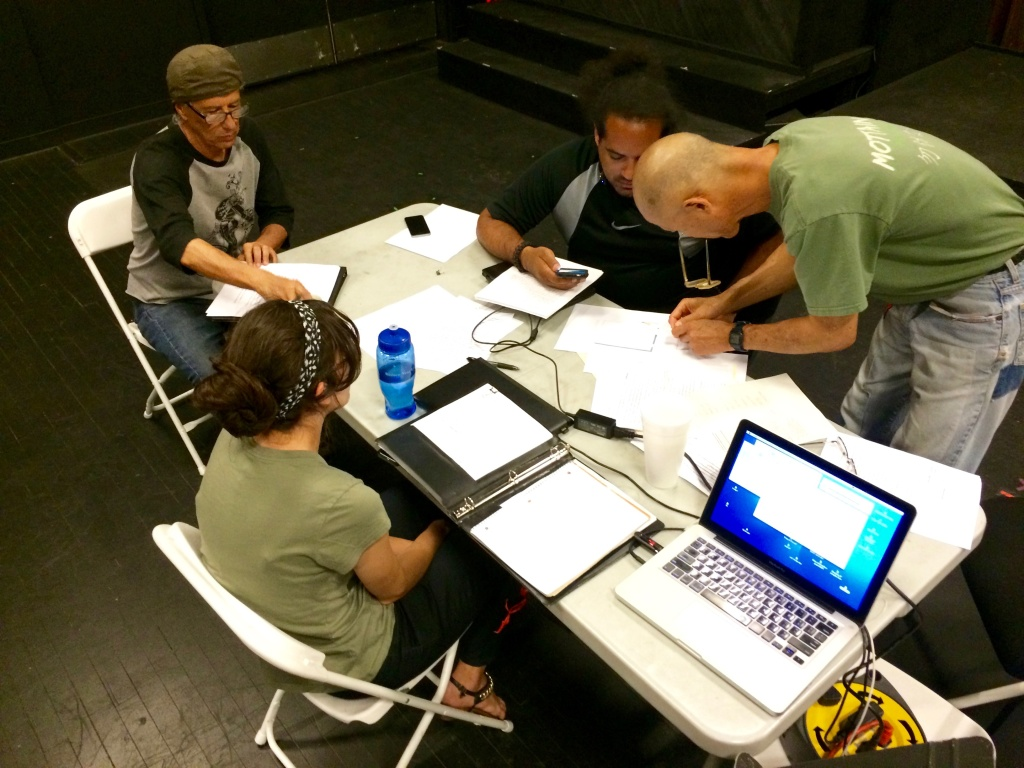 A production meeting at CASA0101 Theater in Boyle Heights. Performer Rubén Guevara grew up in a nearby neighborhood.