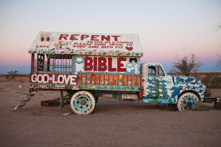 A shot of Salvation Mountain in Niland, California. It appears in National Geographic photographer Aaron Huey's book