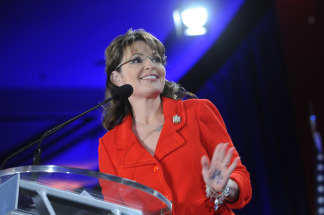 Writing is visible on the palm of former Alaska Governor Sarah Palin's hand as she speaks to delegates at the Southern Republican Leadership Conference, April 9, 2010 in New Orleans, Louisiana.