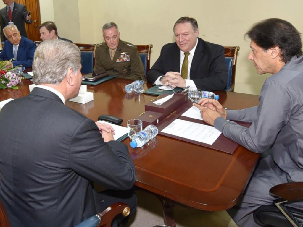 In this photo released by Press Information Department, Pakistan's Prime Minister Imran Khan (right) meets with Secretary of State Mike Pompeo in Islamabad on Wednesday. 2018. Khan said he was