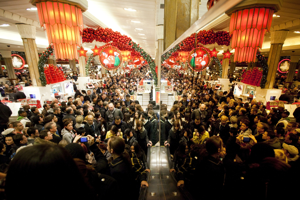 Bargain hunters shop for discounted merchandise at Macy's on 'Black Friday'  in New York City.