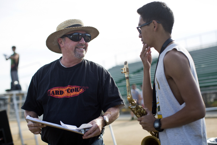 Junior Sunny Dam, left, and sophomore Ted Hui wait for marching band practice to begin at Temple City High School on Wednesday morning, Dec. 24, 2014. The band is set to perform in the 2015 Rose Parade on Jan. 1.