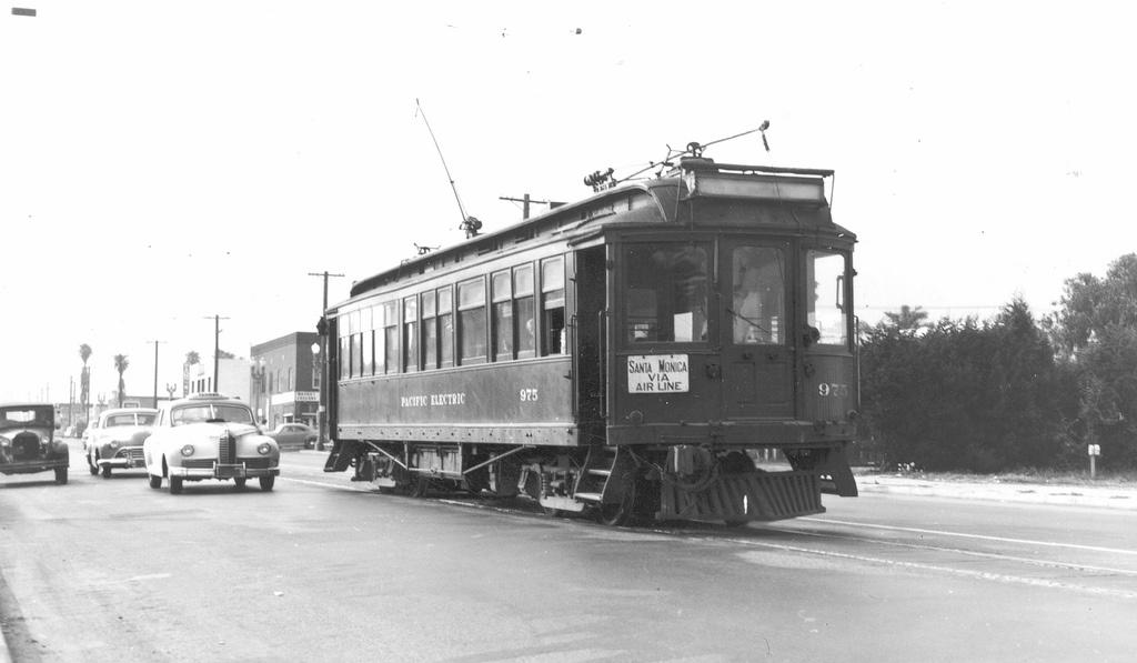 A Red Car on the Santa Monica Air Line makes its way down the street circa 1940.