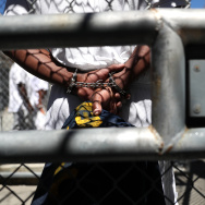 A condemned inmate stands with handcuffs on as he preapres to be released from the exercise yard back to his cell at San Quentin State Prison's death row on August 15, 2016 in San Quentin, California.