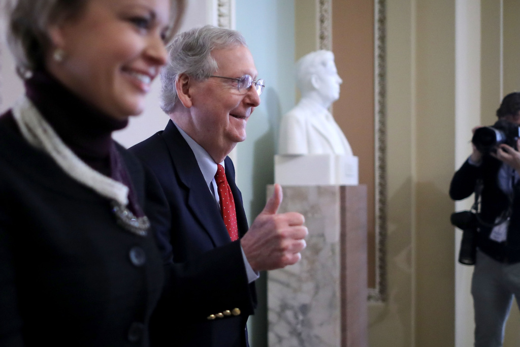 Senate Majority Leader Mitch McConnell gives a thumbs-up at the U.S. Capitol December 1, 2017 in Washington, DC.