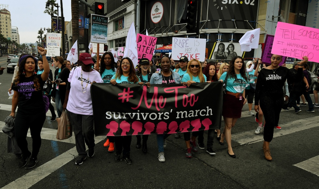 Women who are survivors of sexual harassment, sexual assault, sexual abuse and their supporters protest during a #MeToo march in Hollywood, California on November 12, 2017. Several hundred women gathered in front of the Dolby Theatre in Hollywood before marching to the CNN building to hold a rally. / AFP PHOTO / Mark RALSTON        (Photo credit should read MARK RALSTON/AFP/Getty Images)