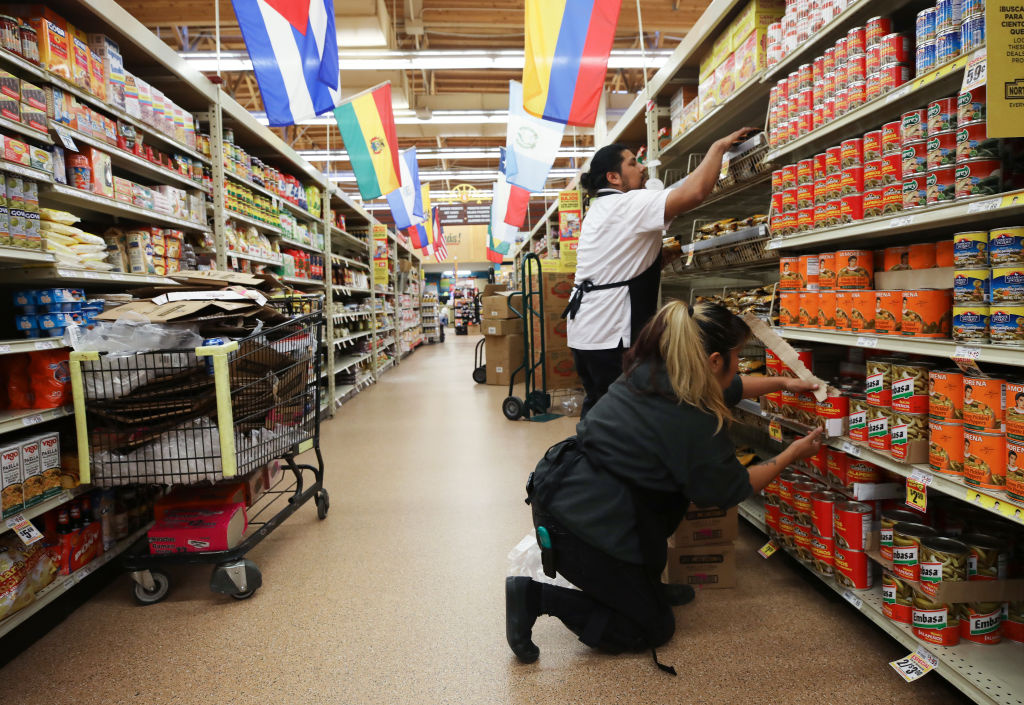 Workers re-stock items at Northgate Gonzalez Market, a Hispanic specialty supermarket, on March 19, 2020 in Los Angeles, California.