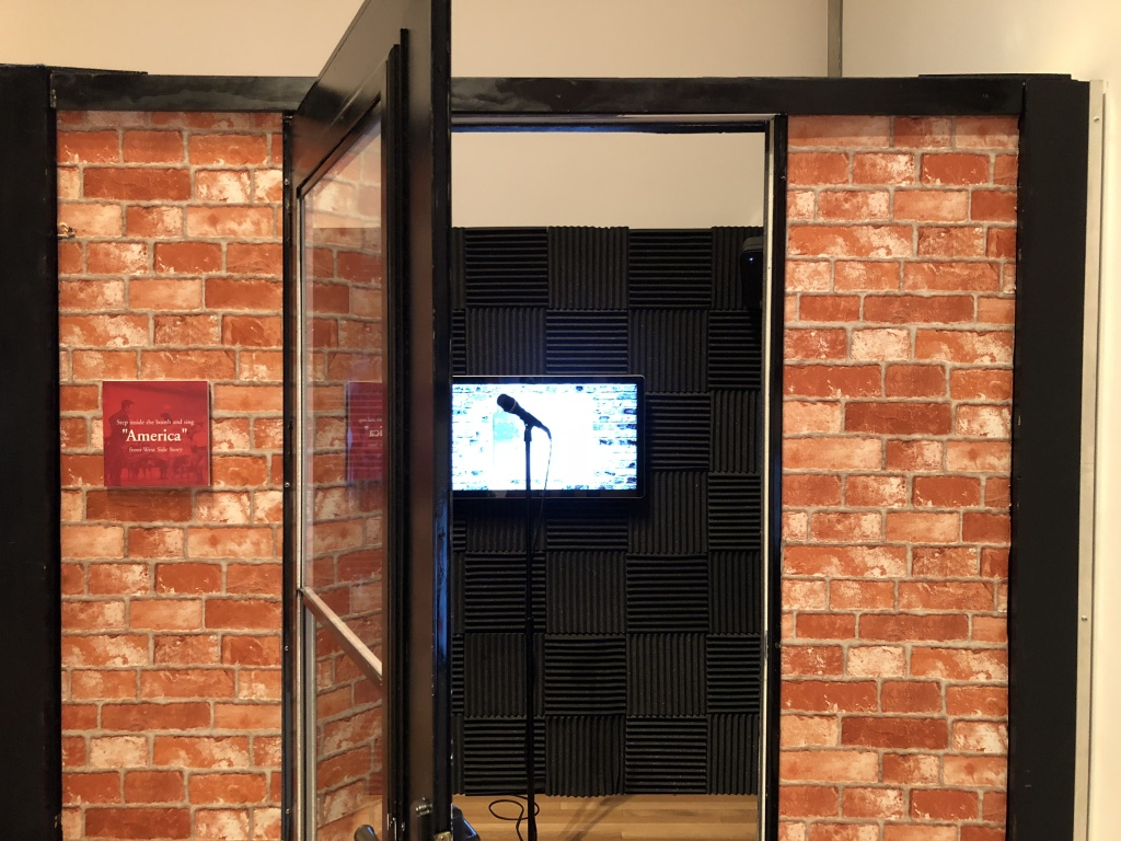 A singing booth dedicated to West Side Story, where visitors can sing along to 'America.'
