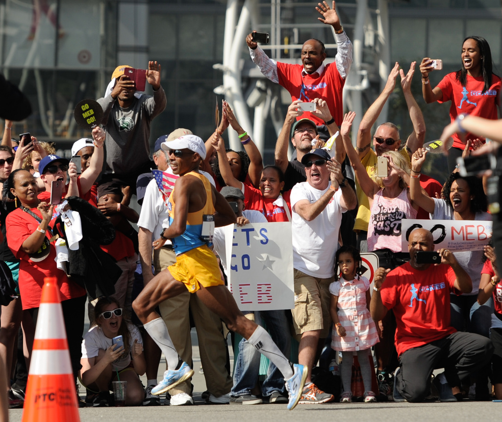 Meb Keflezighi runs past supporters in the U.S. Men's Olympic Marathon Trials on February 13, 2016 in Los Angeles, California.