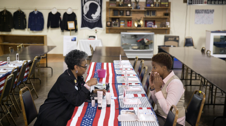 In November, U.S. employers added the most jobs to their payrolls in a year, according to payroll firm ADP. Here, Air Force Staff Sgt. Bri Smith, right, of Atlanta, talks with a Mary Kay consultant during a November job fair for veterans.