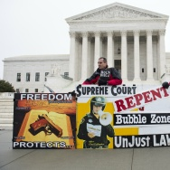 Pro-life demonstrators stand outside the US Supreme Court.