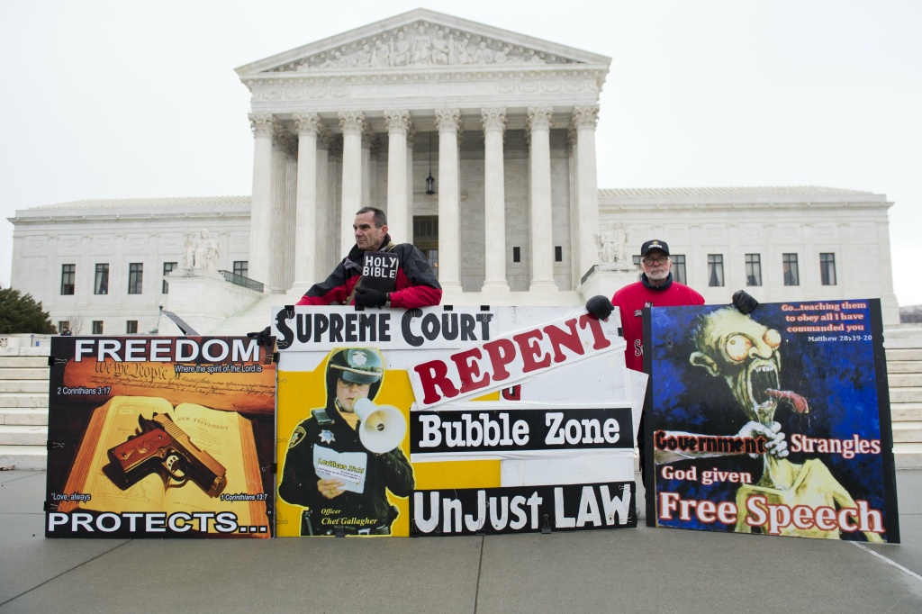 Pro-life demonstrators stand outside the US Supreme Court following oral arguments in the case of McCullen v. Coakley, dealing with a Massachusetts law imposing a 35-foot buffer zone around abortion clinics for demonstrations and protests, in Washington, DC, January 15, 2014. The high court ruled Thursday, June 26, 2014, that extending the buffer zone to 35 feet violated the First Amendment rights of protesters.