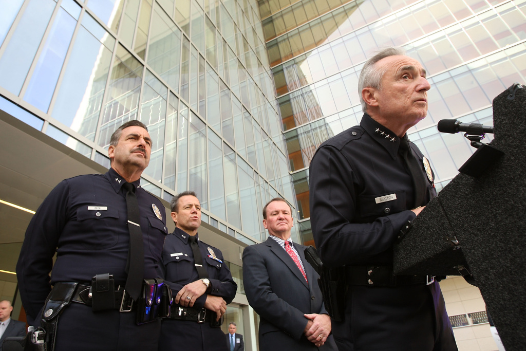 Michel Moore, second from left, is seen here in 2009 with William Bratton, who'd announced he was leaving as LAPD chief. He's flanked by Charlie Beck, who succeeded Bratton, and Jim McDonnell, who's now the L.A. County Sheriff.