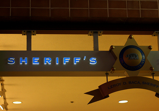 The sign at a Los Angeles County Sheriff's Department substation, June 2011. The department is one of 57 law enforcement agencies in the country that participates in 287(g), a federal-local immigration enforcement program. Its 287(g) contract is not among those expiring Monday, but all contracts will be under review by federal officials.