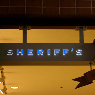 The sign at a Los Angeles County Sheriff's Department substation. The agency seeks to renew a federal-local immigration enforcement partnership, which deputizes county authorities to screen inmates for immigration status and possible deportation.