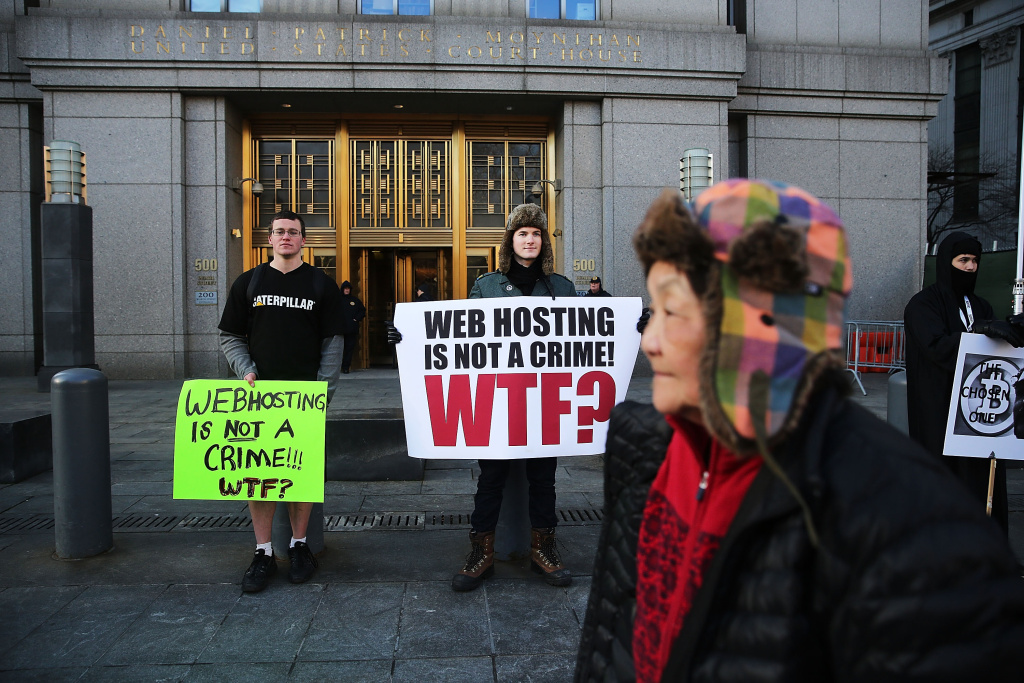 NEW YORK, NY - JANUARY 13:  Supporters of Ross Ulbricht, the alleged creator and operator of the Silk Road underground market, stand in front of a Manhattan federal court house on the first day of jury selection for his trial on January 13, 2015 in New York City. Ulbricht, who has pleaded not guilty, is accused by the US government of making millions of dollars from the Silk Road website which sold drugs and other illegal commodities anonymously.